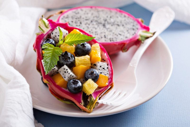 Tropical fruit salad served inside a dragon fruit